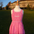 Traditional pink dress with daisy embroideries