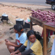 Women Selling Corn - On the road, they serve a meal with fruit, sweetcorn, etc