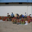 Sorting out the baskets - The artisans arrive with their basket loads