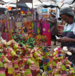 Man selling colourful giraffes - Coum market